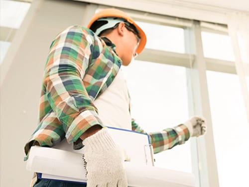 HandiPro professional inspecting windows