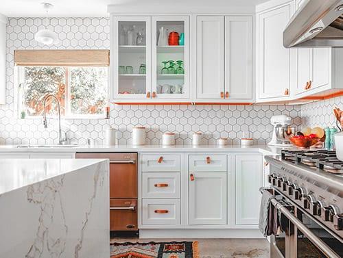 white traditional kitchen remodel with white granite island